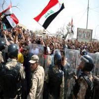 """""""علماء المسلمين"""" يندد باستخدام العنف ضد المتظاهرين العراقيين ويدعو لـ""""نبذ الطائفية"""""""