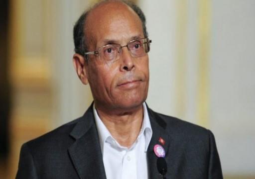 الرئيس التونسي السابق يعتبر أبوظبي من محور الشر