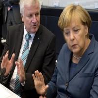 وزير الداخلية الألماني يعرض استقالته إثر خلافات مع ميركل