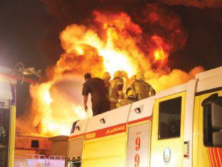 وفاة وإصابة 8 في حريق مستودع بالمصفح