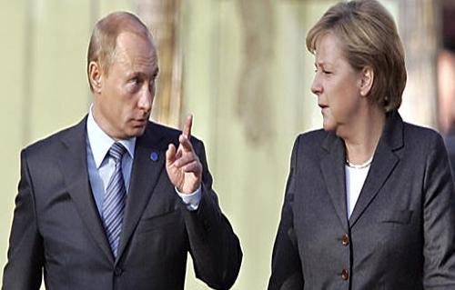 ميركل تطالب الرئيس الروسي بوقف تدفق الأسلحة الى أوكرانيا