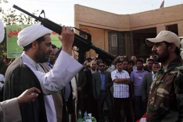 الحشد الشعبي الإرهابي يرتكب جرائم حرب في مدينة الكرمة السنية