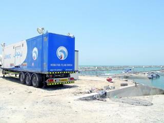 أدنوك تقدم محطة وقود متنقلة لميناء صيادي أم القيوين