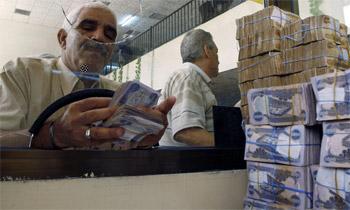 طهران وبغداد تتفقان على تأسيس بنك مشترك