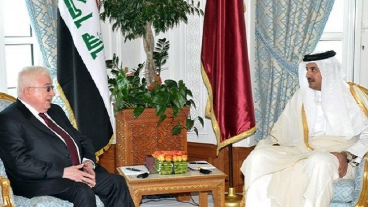 الرئيس العراقي يلتقي أمير قطر في الدوحة
