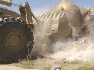داعش يطمس معالم دينية في العراق