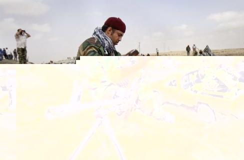 قوات فجر ليبيا تقترب من السيطرة على قاعدة الوطية الجوية