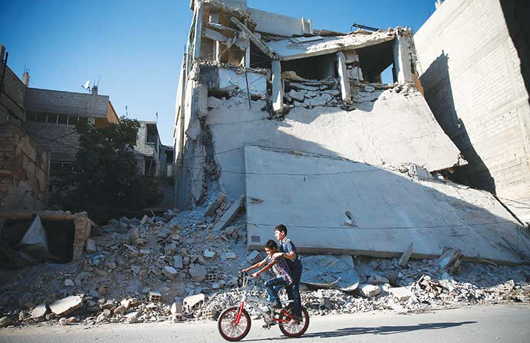 النازيون الجدد الأمريكيون يتخذون بشار الأسد